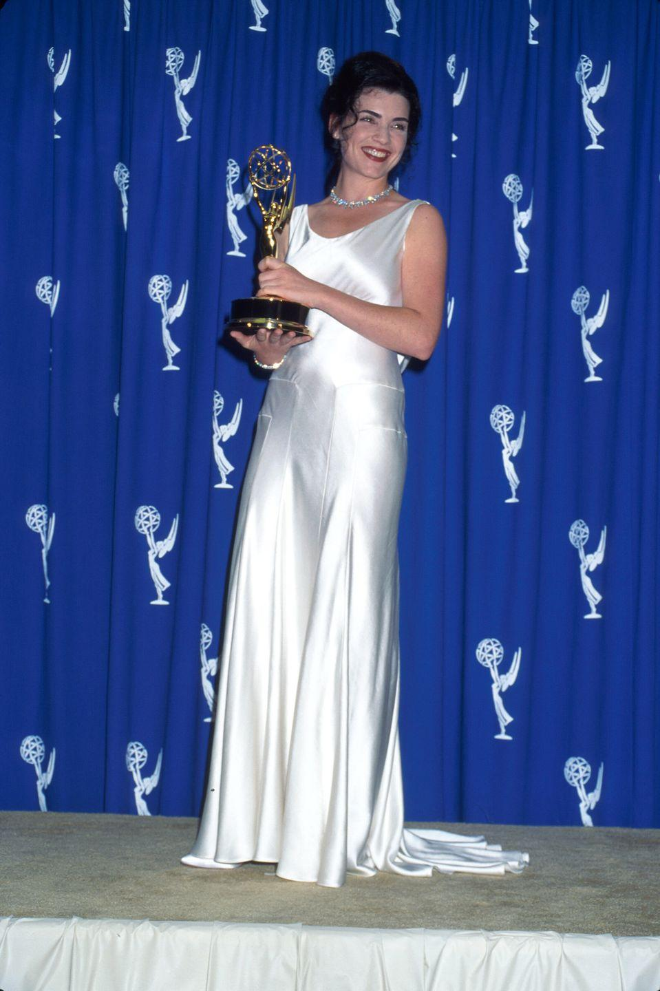 <p>Margulies wore a classic white satin dress to accept her Emmy in 1995.</p>