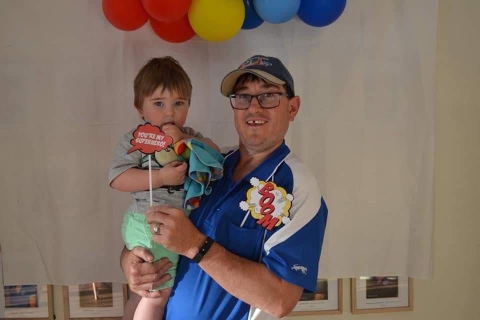 Photo shows Paul Gillett and his son Lachlan.