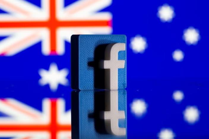 FILE PHOTO: A 3D-printed Facebook logo is seen in front of a displayed Australian flag in this illustration photo