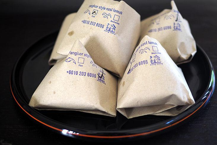 Wrapped in brown paper, the 'nasi lemak' is usually bought in big quantities for the whole family to enjoy