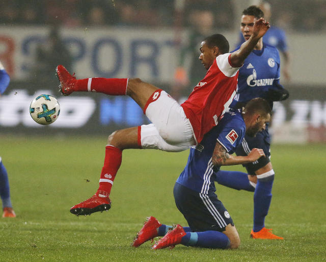 Mainz's Abdou Diallo, left, and Schalke's Guido Burgstaller challenge for the ball during a German first division Bundesliga soccer match between FSV Mainz 05 and FC Schalke 04 in Mainz, Germany, Friday, March 9, 2018.(AP Photo/Michael Probst)