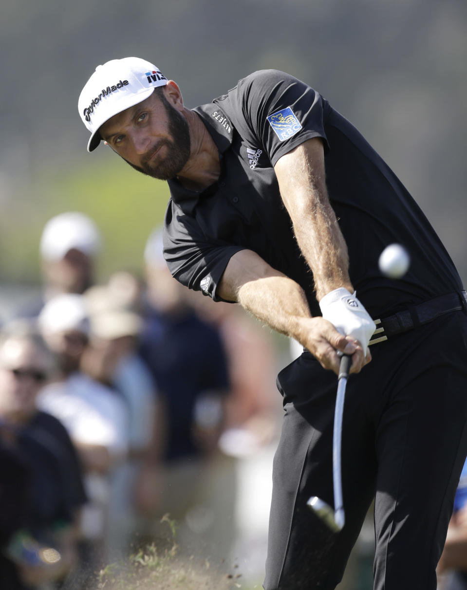 Defending champion Dustin Johnson hits on the 13th hole during round-robin play at the Dell Technologies Match Play golf tournament Wednesday, March 21, 2018, in Austin, Texas. (AP Photo/Eric Gay)
