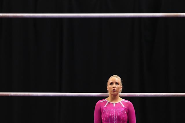ST. LOUIS, MO - JUNE 8: Nastia Liukin prepares to compete on the uneven bars during the Senior Women's competition on day two of the Visa Championships at Chaifetz Arena on June 8, 2012 in St. Louis, Missouri. (Photo by Dilip Vishwanat/Getty Images)