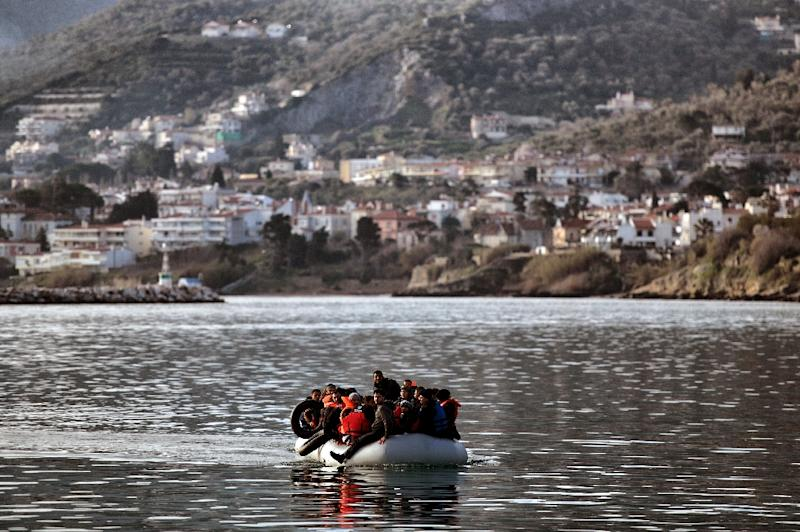 Migrants and refugees on a rubber boat arrive at the northern island of Lesbos after crossing the Aegean sea from Turkey, in Mytilene, on February 23, 2016 (AFP Photo/Aris Messinis)