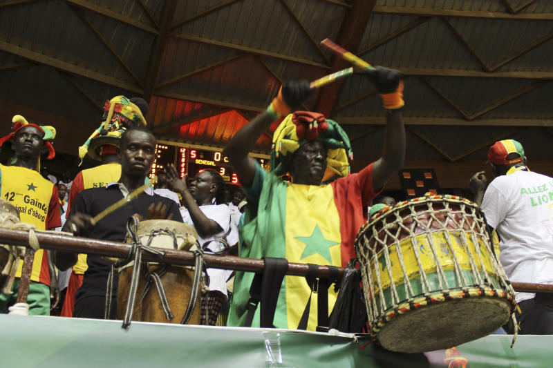 Senegal's supporters drum during an AfroBasket match between Senegal against South Africa at Marius Ndiaye stadium in Dakar, Senegal, Friday, Sept. 8, 2017. The African basketball championship may lack star power, even electrical power on occasion. But with national pride at stake, it almost always entertains. AfroBasket, which tipped off Friday in Senegal and Tunisia, can't be compared to a glitzy event like the NCAA tournament. Senegal's aging national stadium in the capital Dakar, for example, has no air conditioning. A recent women's AfroBasket game in Mali was paused because of a power cut. (AP Photo/ Ken Maguire)