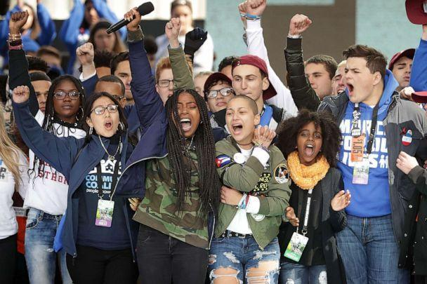 PHOTO: Students from Marjory Stoneman Douglas High School, including Emma Gonzalez, center, stand together on stage with other young victims of gun violence at the conclusion of the March for Our Lives rally on March 24, 2018, in Washington. (Chip Somodevilla/Getty Images, FILE)