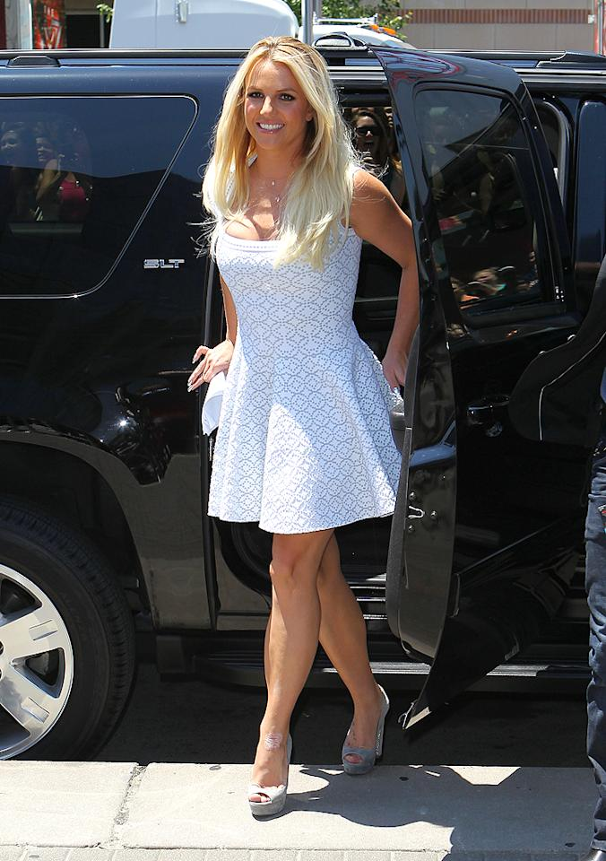 "Also looking lovely in white was Britney Spears, who arrived at the Sprint Center for the first day of ""X Factor"" auditions in Kansas City, Missouri, in this feminine Azzedine Alaia frock and gray Miu Miu platform peep-toes. Has Brit gotten her groove back, or is it still too soon to tell? (6/8/2012)"
