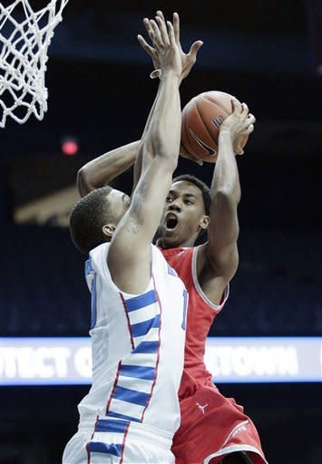 Austin Peay forward Preston Herring, right, drives to the basket against DePaul center Derrell Robertson Jr., during the first half of an NCAA college basketball game in Rosemont, Ill., on Saturday, Nov. 17, 2012. (AP Photo/Nam Y. Huh)