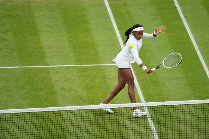 Coco Gauff of the U.S. plays against Russia's Veronika Kudermetova and Elena Vesnina during the women's doubles third round match on day eight of the Wimbledon Tennis Championships in London, Tuesday, July 6, 2021. (AP Photo/Alberto Pezzali)