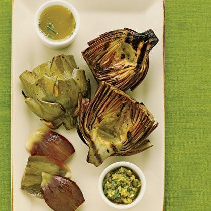 """<p>Grill these <a href=""""https://www.myrecipes.com/t/vegetables/artichokes/"""" rel=""""nofollow noopener"""" target=""""_blank"""" data-ylk=""""slk:artichokes"""" class=""""link rapid-noclick-resp"""">artichokes</a> until tender and slightly browned and serve with green olive dip for a truly special appetizer or side dish.</p>"""