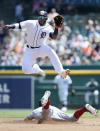 Detroit Tigers shortstop Niko Goodrum jumps above Washington Nationals' Trea Turner in an attempt to catch a high throw on a pickoff attempt during the first inning of a baseball game Sunday, June 30, 2019, in Detroit. The ball was fielded by second baseman Gordon Beckham. (AP Photo/Duane Burleson)