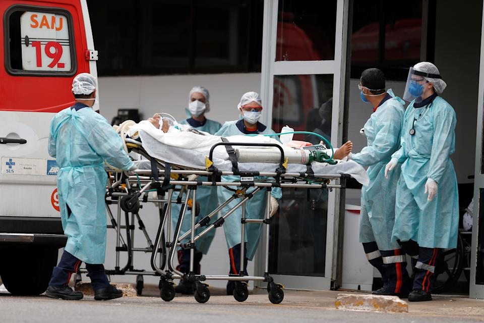 BRASILIA, March 11, 2021 -- A patient infected with COVID-19 is wheeled into a hospital in Brasilia, Brazil, March 11, 2021. Brazil recorded 2,233 new COVID-19 deaths in the last 24 hours, the second highest daily increase, taking the national death toll to 272,889, the Health Ministry said Thursday. (Photo by Lucio Tavora/Xinhua via Getty) (Xinhua/Lucio Tavora via Getty Images)