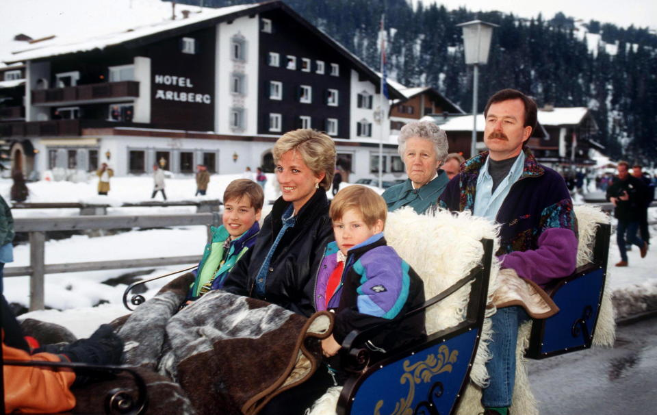 AUSTRIA - MARCH 30:  Princess Diana With Prince William And Prince Harry In A Sleigh In Austria.in The Back Are The Prince's Nanny Olga Powell And Police Bodyguard Trevor Bettles  (Photo by Tim Graham Photo Library via Getty Images)