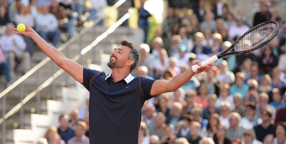 Former tennis pro Goran Ivanisevic celebrates during the match against former tennis pro Michael Stich.