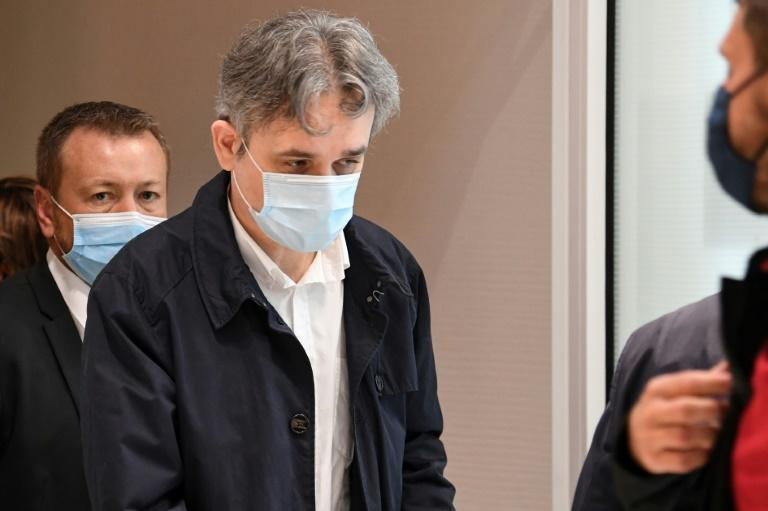 Charlie Hebdo's director Laurent Sourisseau walks out of the the Paris courthouse on September 9, 2020, during a hearing of the trial of 14 suspected accomplices the jihadist attacks on the French satirical weekly