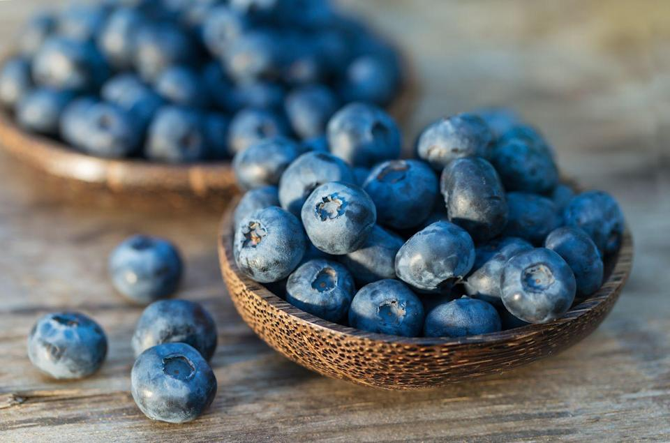 """<p>Blueberries may very well be the most potent age-defying food—they're jam-packed with antioxidants. Research shows a diet rich in blueberries can help with memory loss, prevent <a href=""""https://www.prevention.com/health/a20433449/8-most-common-causes-of-utis/"""" rel=""""nofollow noopener"""" target=""""_blank"""" data-ylk=""""slk:urinary tract infections"""" class=""""link rapid-noclick-resp"""">urinary tract infections</a>, and relieve eyestrain. Add up to 1/2 cup of blueberries to your diet a day for maximum health benefits, recommends Ronald Prior, PhD, adjunct professor of food science at the University of Arkansas in Fayetteville. This alone provides just about double the amount of antioxidants most Americans get in one day.</p><p><strong>Try it: </strong><a href=""""https://www.prevention.com/food-nutrition/recipes/a20525696/baked-peaches-with-blueberries/"""" rel=""""nofollow noopener"""" target=""""_blank"""" data-ylk=""""slk:Baked Peaches with Blueberries"""" class=""""link rapid-noclick-resp"""">Baked Peaches with Blueberries</a></p>"""