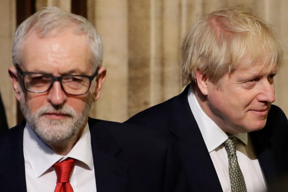 Britain's Prime Minister Boris Johnson (R) and Labour Party Leader Jeremy Corbyn (L) walk through the Commons Members Lobby during the State Opening of Parliament at the Houses of Parliament in London on December 19, 2019. - The State Opening of Parliament is where Queen Elizabeth II performs her ceremonial duty of informing parliament about the government's agenda for the coming year in a Queen's Speech. (Photo by Kirsty Wigglesworth / POOL / AFP) (Photo by KIRSTY WIGGLESWORTH/POOL/AFP via Getty Images)