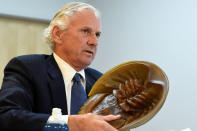 South Carolina Gov. Henry McMaster holds a model of a horseshoe crab, whose blood is a vital component in the contamination testing of injectable medicines - including the coronavirus vaccines - at Charles River Labs on Friday, Aug. 6, 2021, in Charleston, S.C. (AP Photo/Meg Kinnard)