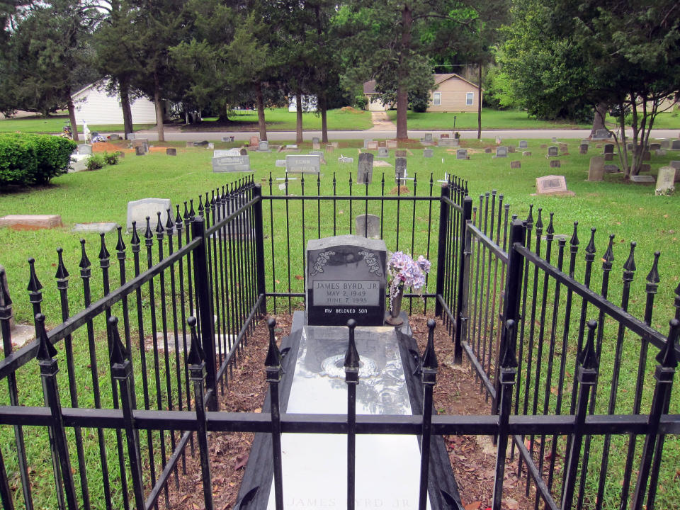 This April 12, 2019, photo shows the gravesite of James Byrd Jr. in Jasper, Texas. Byrd was killed on June 7, 1998, after he was chained to the back of a pickup truck and dragged for nearly three miles along a secluded road in the piney woods outside Jasper in what is considered one of the most gruesome hate crime murders in recent Texas history. (AP Photo/Juan Lozano)