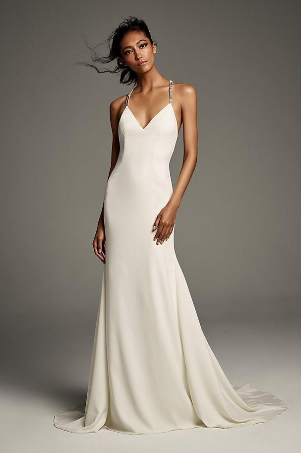 """<p>This <a href=""""https://www.popsugar.com/buy/Crystal-T-Back-Stretch-Crepe-Slip-Gown-Ribbon-582296?p_name=Crystal%20T-Back%20Stretch%20Crepe%20Slip%20Gown%20with%20Ribbon&retailer=davidsbridal.com&pid=582296&price=478&evar1=fab%3Aus&evar9=47551973&evar98=https%3A%2F%2Fwww.popsugar.com%2Fphoto-gallery%2F47551973%2Fimage%2F47552349%2FCrystal-T-Back-Stretch-Crepe-Slip-Gown-with-Ribbon&list1=shopping%2Cwedding%2Cbride%2Cwedding%20dresses%2Cfashion%20shopping%2Cbest%20of%202020&prop13=api&pdata=1"""" class=""""link rapid-noclick-resp"""" rel=""""nofollow noopener"""" target=""""_blank"""" data-ylk=""""slk:Crystal T-Back Stretch Crepe Slip Gown with Ribbon"""">Crystal T-Back Stretch Crepe Slip Gown with Ribbon</a> ($478) will never go out of style.</p>"""
