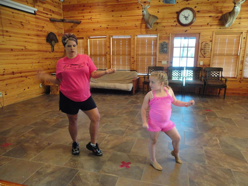 Alana (Honey Boo Boo) (R) with her dance coach, Amanda Carter.