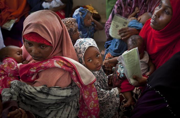 Somali mothers and their babies wait in line for the babies to receive a five-in-one vaccine against several potentially fatal childhood diseases, at the Medina Maternal Child Health center in Mogadishu, Somalia Wednesday, April 24, 2013. On the eve of the Global Vaccine Summit in Abu Dhabi and coinciding with World Immunization Week, the authorities in Somalia, which has one of the lowest immunization rates in the world, launched the new deployment of a pentavalent vaccine against diphtheria, tetanus, whooping cough, hepatitis B, and haemophilus influenzae type B the bacteria that causes meningitis and pneumonia. (AP Photo/Ben Curtis)