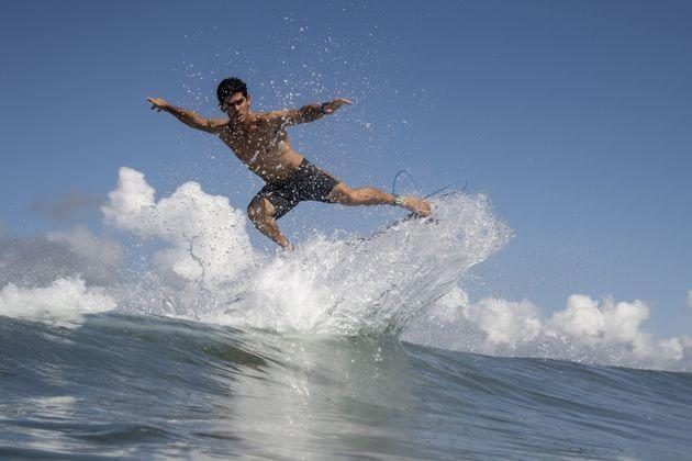 Chile's Manuel Selman rides a wave during a free training session. (Photo: OLIVIER MORIN via Getty Images)