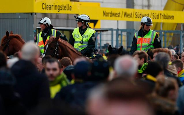 <span>Police patrol on horseback outide the stadium after the team bus of Borussia Dortmund</span> <span>Credit: ODD ANDERSEN/AFP </span>