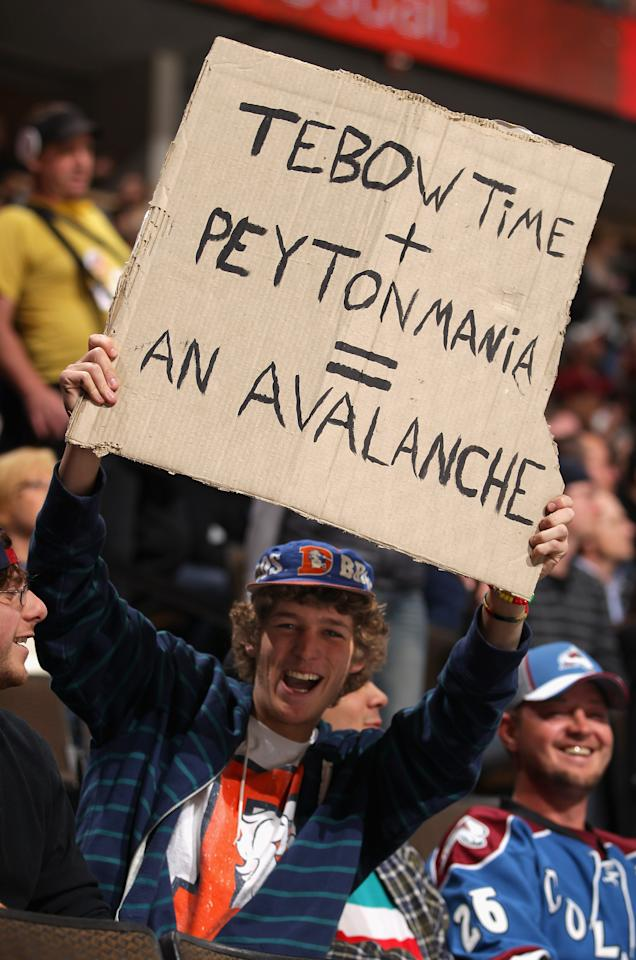 DENVER, CO - MARCH 20:  A fan displays a sign referencing Denver Broncos quarterbacks Tim Tebow and Peyton Manning as the Colorado Avalanche host the Calgary Flames at Pepsi Center on March 20, 2012 in Denver, Colorado.  (Photo by Doug Pensinger/Getty Images)
