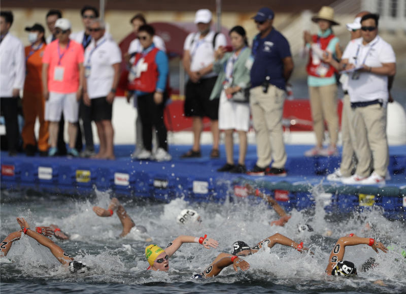 Swimmers compete during the women's 5km open water swim at the World Swimming Championships in Yeosu, South Korea, Wednesday, July 17, 2019. (AP Photo/Mark Schiefelbein)