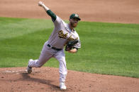 Oakland Athletics starting pitcher Paul Blackburn throws during the first inning of a baseball game against the Kansas City Royals Thursday, Sept. 16, 2021, in Kansas City, Mo. (AP Photo/Charlie Riedel)