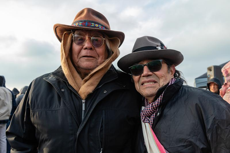 """Lenny Foster (left), a Diné spiritual advisor to over 2000 Native American inmates, and Tony Gonzales. Gonzales, director of the American Indian Movement—West, was in Vietnam during the 1969 action. """"We need to Indianize 7 billion people,"""" he says, to foster in them a """"connection to nature, to our allies of the animal and plant world."""""""