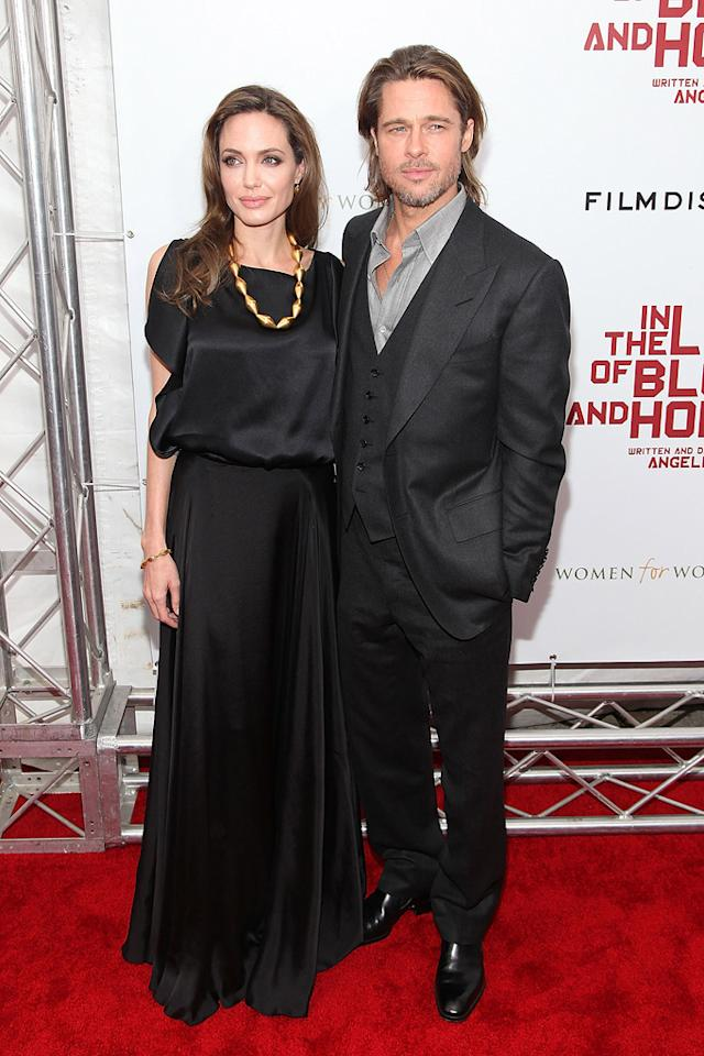 "<a href=""http://movies.yahoo.com/movie/contributor/1800019275"">Angelina Jolie</a> and <a href=""http://movies.yahoo.com/movie/contributor/1800018965"">Brad Pitt</a> at the New York premiere of <a href=""http://movies.yahoo.com/movie/1810186173/info"">In the Land of Blood and Honey</a> on December 5, 2011."