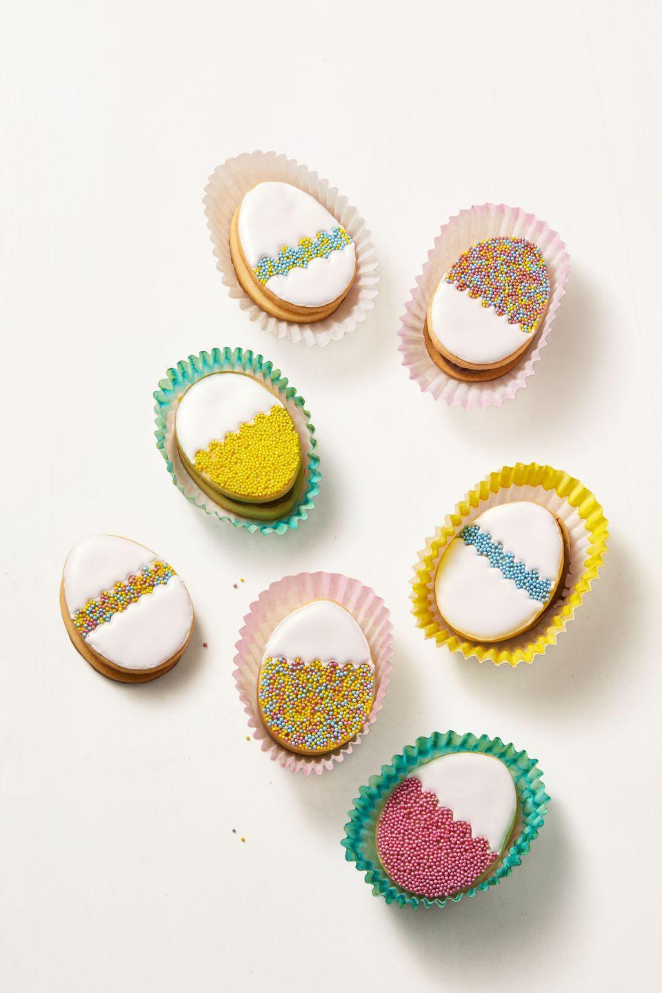 "<p>Make your favorite batch of egg-shaped sugar cookies and then sandwich them together with buttercream or chocolate-hazelnut spread. The rest is up to you: Decorate 'em with royal icing and nonpareils. </p><p><em><a href=""https://www.goodhousekeeping.com/food-recipes/a6874/sugar-cookies-4477/"" rel=""nofollow noopener"" target=""_blank"" data-ylk=""slk:Get the recipe for Easy Sugar Cookies »"" class=""link rapid-noclick-resp"">Get the recipe for Easy Sugar Cookies »</a></em></p>"
