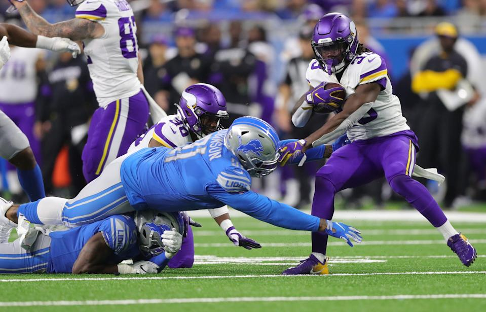 Detroit Lions defenders try to tackle Minnesota Vikings running back Dalvin Cook during the first half Sunday, Oct. 20, 2019 at Ford Field.