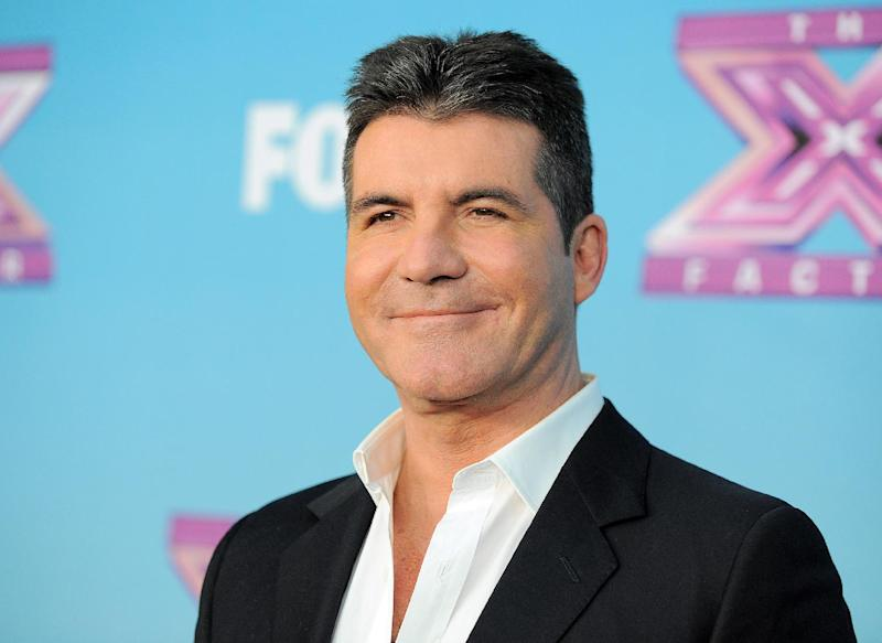 """FILE - This Dec. 20, 2012 file photo shows Simon Cowell at the """"The X Factor"""" season finale results show at CBS Television City in Los Angeles. The new season of """"America's Got Talent"""" starts Tuesday at 9 p.m. EDT. New judges include former Spice Girl Mel B. and supermodel/personality Heidi Klum joining forces with Howie Mandel and Howard Stern. (Photo by Jordan Strauss/Invision/AP, file)"""