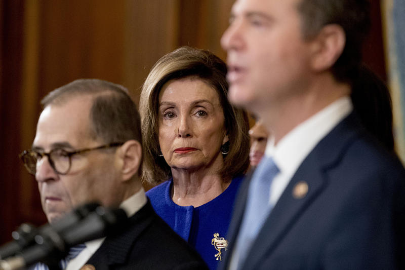 Pelosi and Chairman of the House Judiciary Committee Jerrold Nadler, left, listen as Adam Schiff, Chairman of the House Intelligence Committee, speaks during a news conference to unveil articles of impeachment against Trump on December 10.