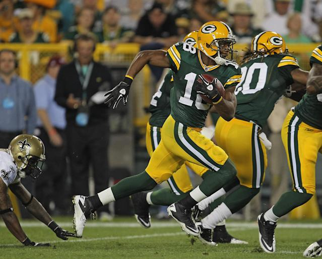 GREEN BAY, WI - SEPTEMBER 08: Randall Cobb #18 of the Green Bay Packers returns a kick-off for a touchdown agaisnt the New Orleans Saints during the NFL opening season game at Lambeau Field on September 8, 2011 in Green Bay, Wisconsin. (Photo by Jonathan Daniel/Getty Images)