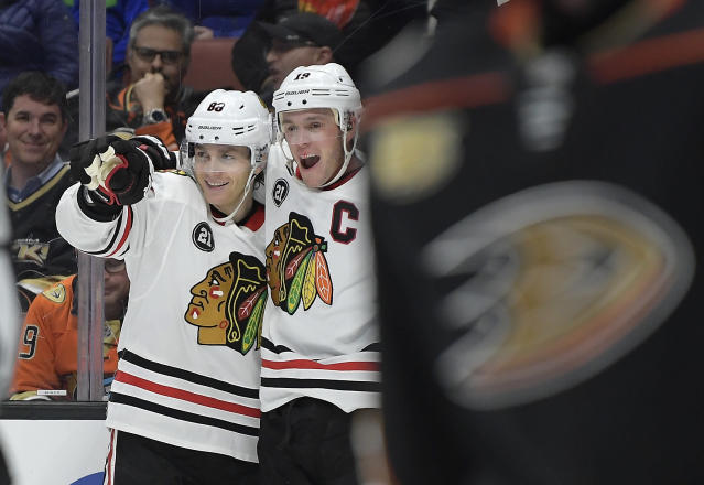 Chicago Blackhawks right wing Patrick Kane, left, celebrates his goal with center Jonathan Toews during the third period of an NHL hockey game against the Anaheim Ducks on Wednesday, Feb. 27, 2019, in Anaheim, Calif. The Blackhawks won 4-3. (AP Photo/Mark J. Terrill)