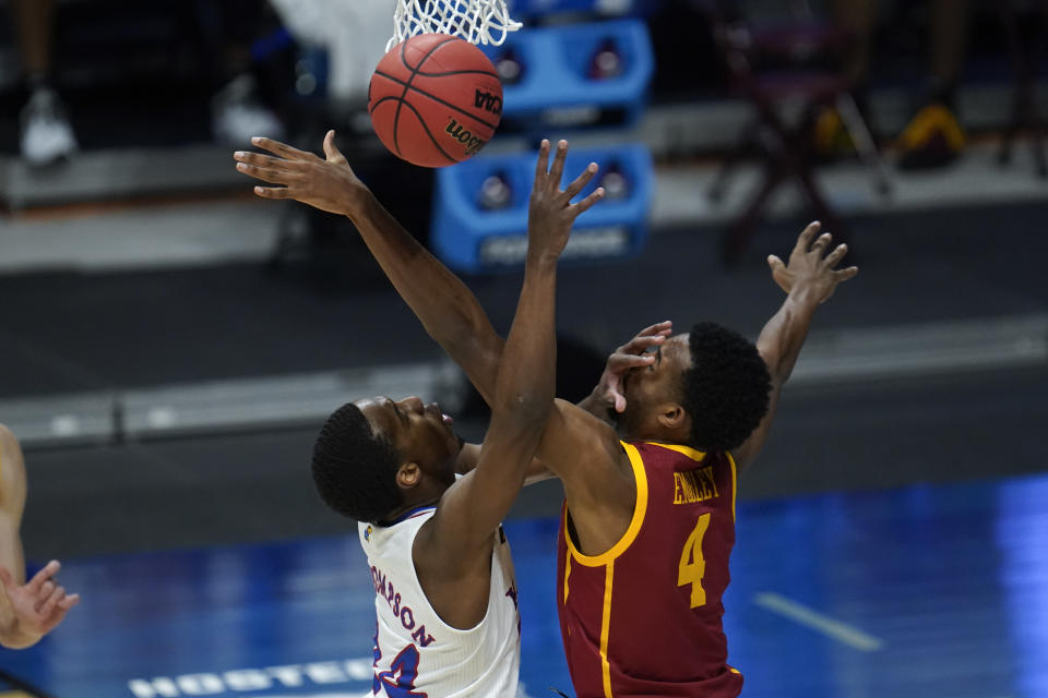 Kansas guard Bryce Thompson (24) and USC forward Evan Mobley (4) battle for a rebound during the first half of a men's college basketball game in the second round of the NCAA tournament at Hinkle Fieldhouse in Indianapolis, Monday, March 22, 2021. (AP Photo/Paul Sancya)
