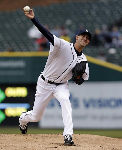 Detroit Tigers pitcher Rick Porcello throws against the Toronto Blue Jays in the first inning of a baseball game in Detroit, Wednesday April 10, 2013. (AP Photo/Paul Sancya)