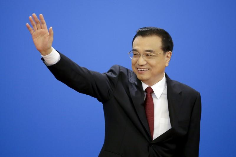 China's Premier Li Keqiang arrives for news conference after the closing session of the National People's Congress (NPC) at the Great Hall of the People in Beijing