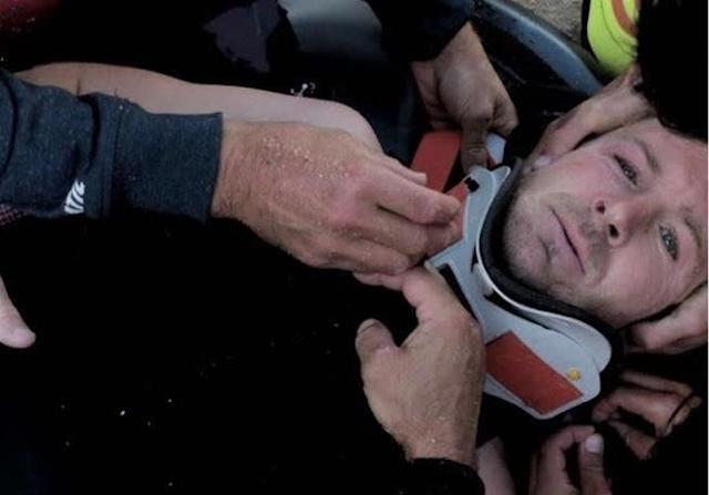 Pain shows in Andrew Cotton's eyes as he's strapped to a stretcher.