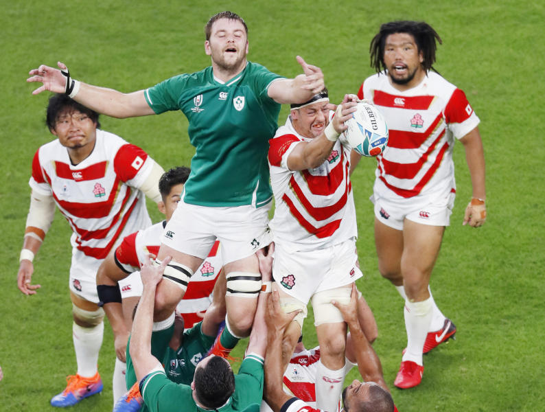 Japan's Luke Thompson, center right, is held aloft to win a lineout during the Rugby World Cup Pool A game at Shizuoka Stadium Ecopa between Japan and Ireland in Shizuoka, Japan, Saturday, Sept. 28, 2019. (Kyodo News via AP)
