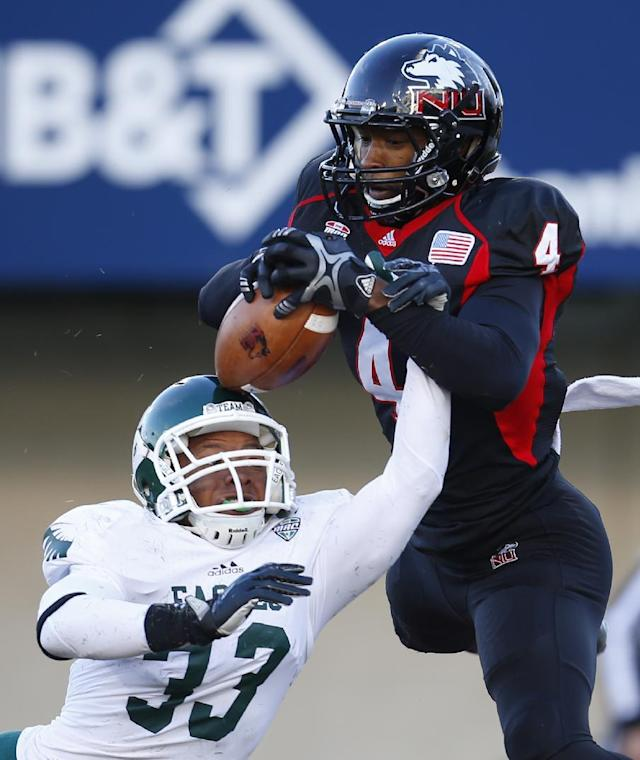 Northern Illinois wide receiver Da'Ron Brown (4) catches a touchdown pass off the head of Eastern Michigan defensive back Quan Pace (33) during the second half of an NCAA college football game, Saturday, Oct. 26, 2013, in DeKalb, Ill. (AP Photo/Jeff Haynes)