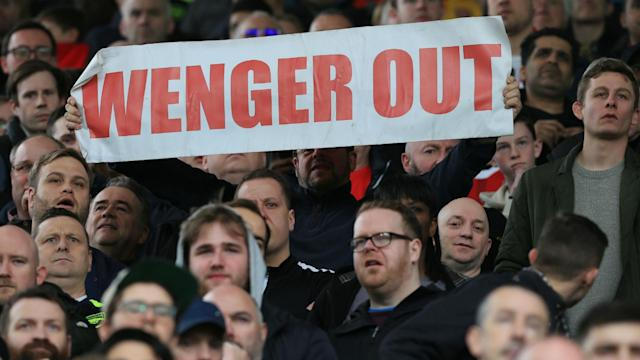 What do Jacob Zuma and Arsene Wenger have in common? They both have 'Out' banners in their names during historic protests in South Africa on Friday