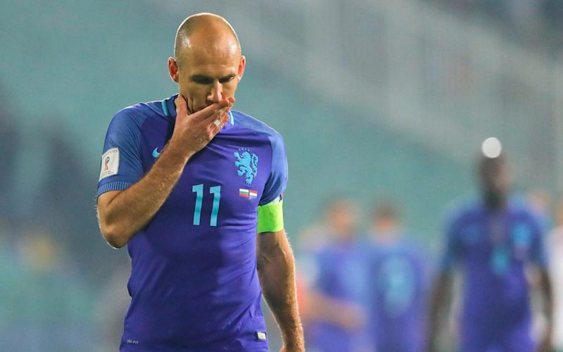 Arjen Robben leaves the field after a disappointing Holland performance - AP