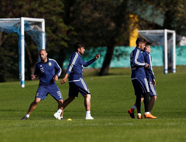 Football Soccer - Argentina's national soccer team training - World Cup 2018 - Buenos Aires, Argentina - May 16, 2018 - Argentina's player Javier Mascherano, Eduardo Salvio, Manuel Lanzini and Nicolas Tagliafico attend a training session. REUTERS/Martin Acosta