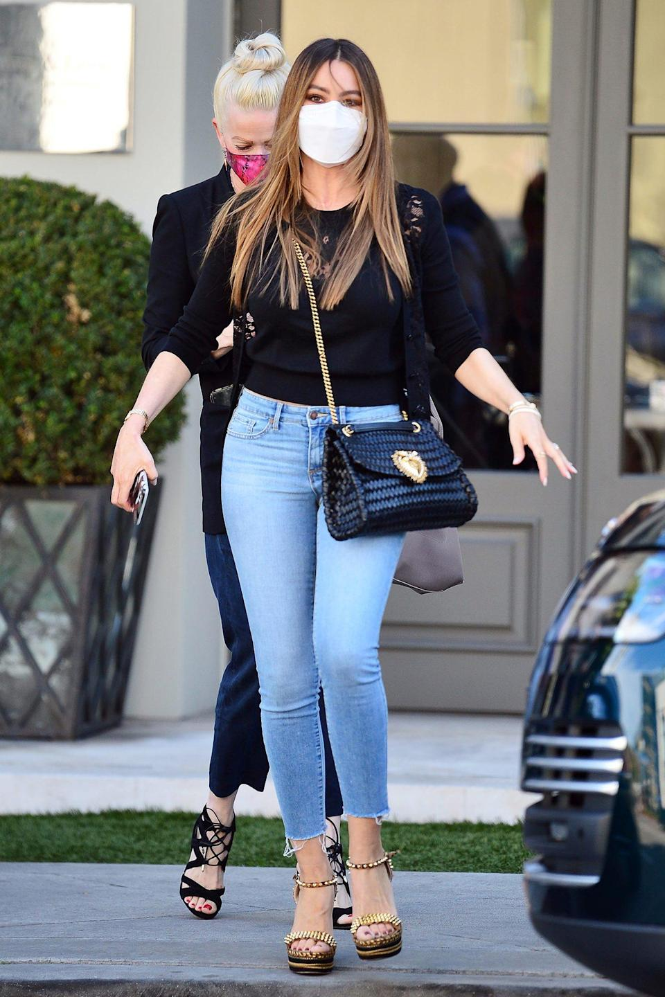 <p>Sofia Vergara keeps things casual in jeans and a lace top to meet up with a friend in L.A. on Wednesday. </p>