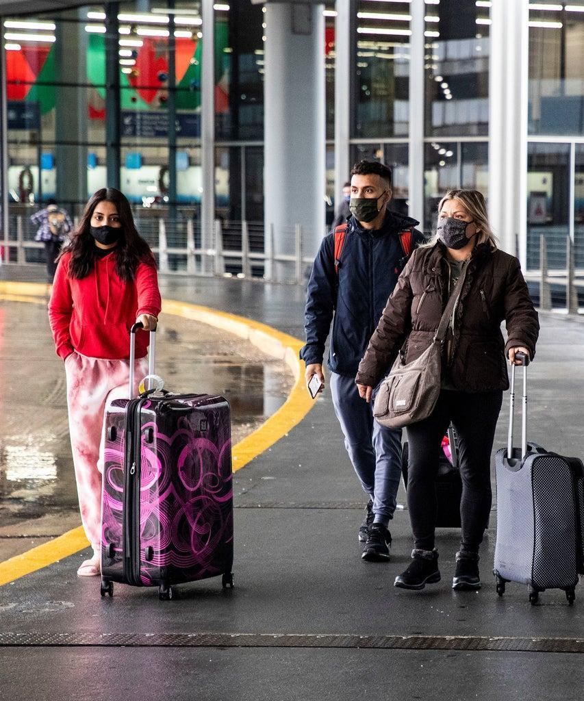 CHICAGO, Nov. 25, 2020 — Travelers wearing face masks are seen at O'Hare International Airport in Chicago, the United States, on Nov. 25, 2020. U.S. Midwest state of Illinois reported 11,378 new COVID-19 cases and 155 new deaths on Wednesday, according to local public health officials. This is the second-highest daily death count the state has suffered in the second wave of the COVID-19 pandemic, the Chicago Sun-Times reported. (Photo by Joel Lerner/Xinhua via Getty) (Xinhua/Joel Lerner via Getty Images)